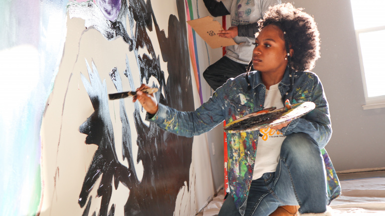Wilmington's Youth contributes to Teen Warehouse by painting a mural